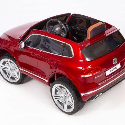 Электромобиль Volkswagen Touareg красный (колеса резина, сиденье кожа, пульт, звуковые эффекты)